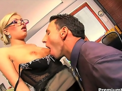 Donna Bell is looking really intimidating with her thick rimmed glasses, but behind that bossy appearance lies a slut ready to fuck her employee during working hours!