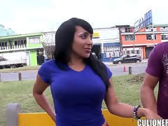 Black haired big ass provocative sexy milf Sandra with pretty face acts like floozy while getting filmed outdoor and enjoys revealing her biggest fake tits in public in close up.