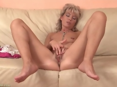 Cute mature golden-haired plays with her tight vagina